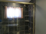 Clear glass shower enclosure Brass.