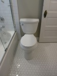 After - New toilet, new octagon tile on the floor